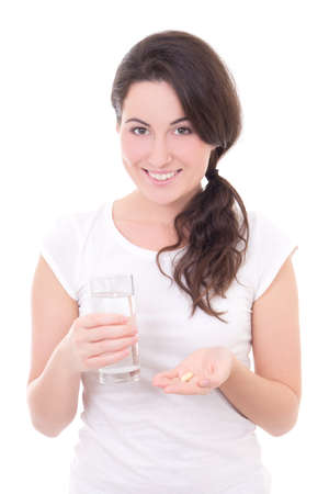 young smiling woman with pill and glass of water isolated on white background photo