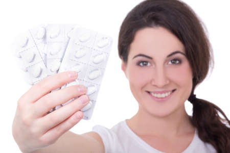 young attractive woman showing blister of pills isolated on white background Stock Photo - 24289112