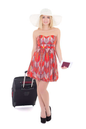 young attractive blondie woman in red dress with suitcase, passport and ticket isolated on white background photo