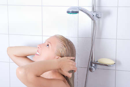young attractive woman having a shower in bathroom