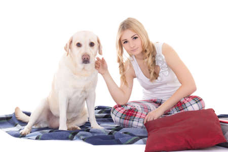 young beautiful blond in pajamas with dog  photo