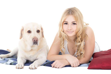young beautiful blond in pajamas lying with dog  photo