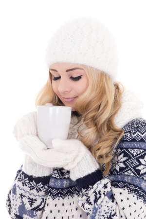 beautiful girl in winter clothes with cup of tea  photo