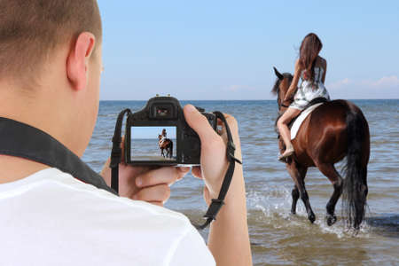 man with dslr camera taking picture of beautiful woman on the horse