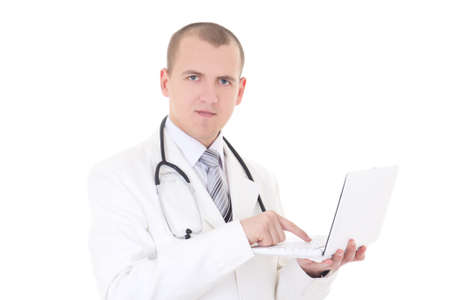 young male doctor using laptop isolated on white background photo