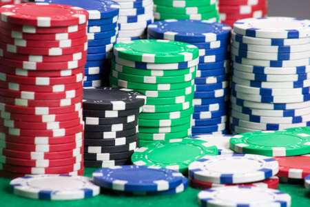 poker chips on a green casino table photo