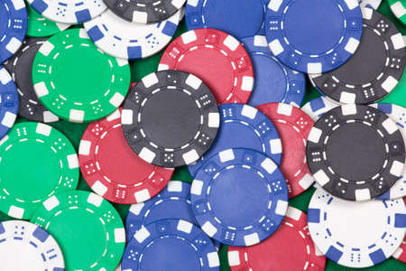 close up of colorful poker playing chips on the table photo
