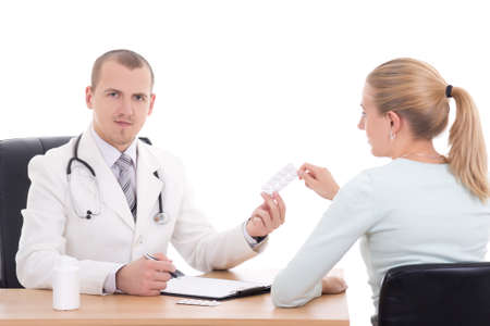 doctor giving pills: doctor giving pills to young woman isolated on white background
