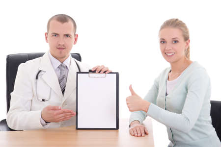 female patient thumbs up and doctor holding folder with copyspace isolated on white photo