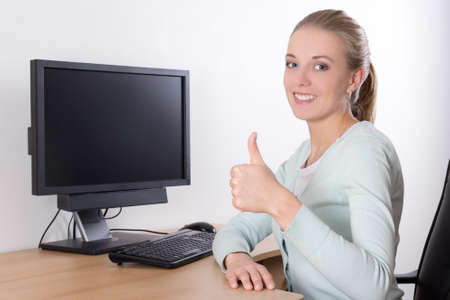 happy woman using pc with copy space on screen and thumbs up photo