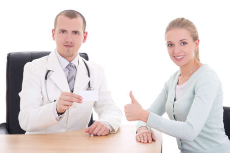 female patient and doctor holding visiting card isolated on white background photo
