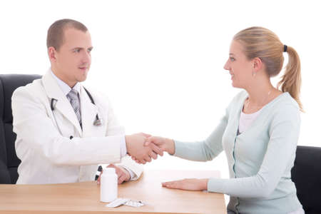 young doctor shaking hands to patient in the office isolated on white photo