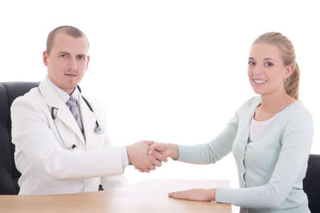 young male doctor shaking hands to female patient in the office isolated on white photo