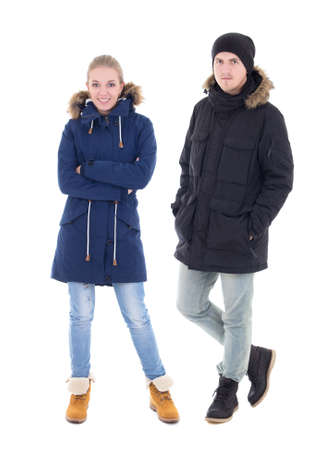 portrait of young handsome man and woman in black winter jackets isolated on white background photo