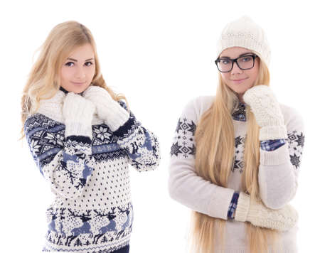 two young attractive girlfriends in winter clothes isolated on white background photo