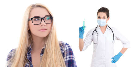 cute blondie girl in eyeglasses with doctor isolated on white background photo