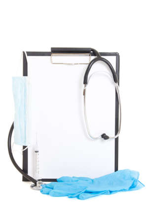 clipboard with blank paper sheet and medical supplies isolated on white background photo