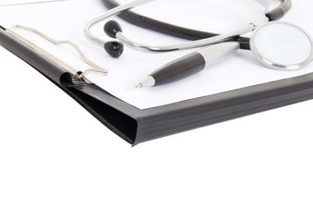 close up of clipboard, pen and stethoscope isolated on white background photo