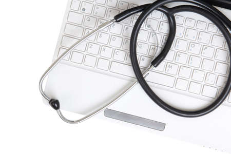 stethoscope on the laptop keyboard over white  photo