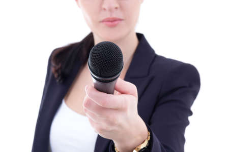 microphone in female  reporters hand over white background photo