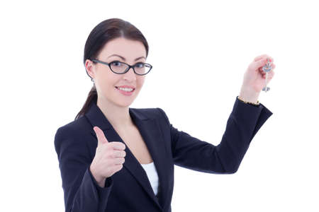 young attractive business woman with key in hand thumbs up isolated on white background photo