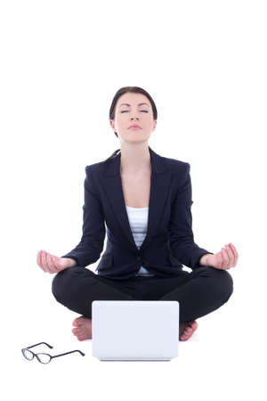 young businesswoman sitting in yoga pose with laptop isolated on white background photo