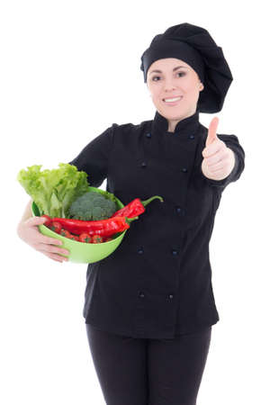 young attractive cook woman in black uniform with vegetables thumbs up isolated on white background photo
