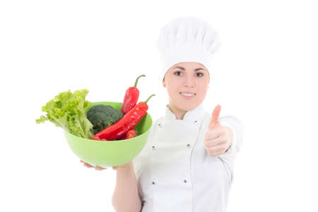 young attractive cook woman in uniform with vegetables thumbs up isolated on white background photo