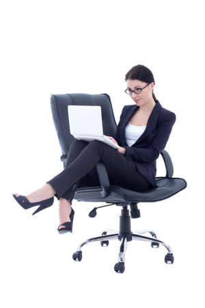 cute business woman sitting on chair and working with laptop isolated over white background photo