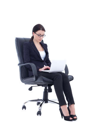 business woman sitting on chair and working with laptop isolated over white background photo
