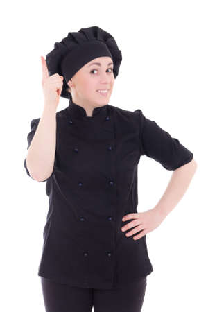 cook woman in black uniform pointing finger up isolated on white background photo