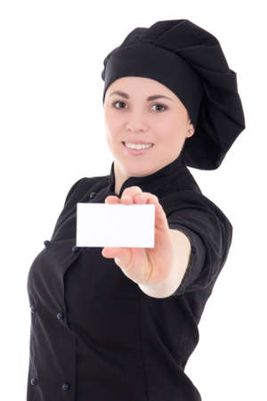 young cook woman in black uniform showing visiting card isolated on white background photo