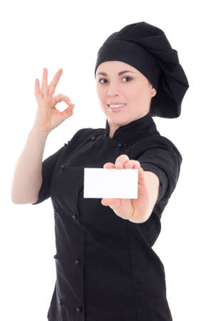 young chef woman in black uniform showing visiting card isolated on white background photo