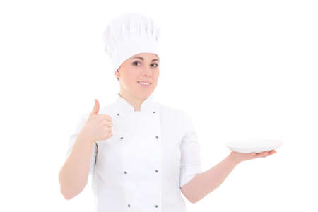 portrait of young cook woman in uniform with empty plate thumbs up isolated on white background photo