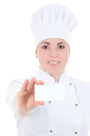 portrait of young cook woman in uniform showing visiting card isolated on white background photo