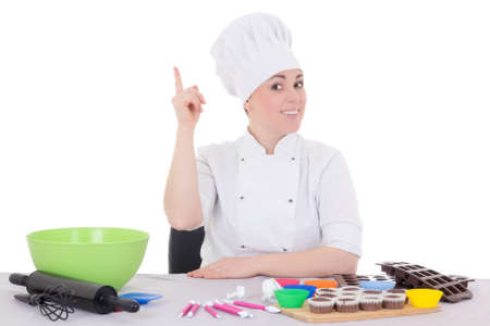 attractive female confectioner in cook uniform sitting at the kitchen isolated on white background photo