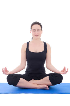 pretty young woman in a meditative yoga pose isolated on white background photo