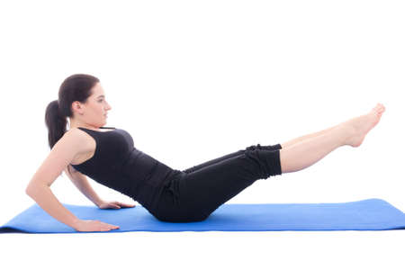 sporty woman doing strength exercises for abdominal muscles isolated on white background photo