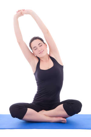 beautiful woman stretching hands on yoga mat isolated on white background photo