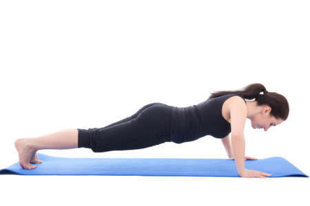 young sporty woman doing push up exercise isolated on white background photo