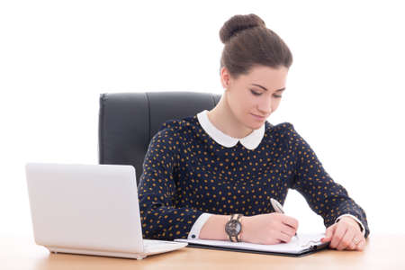 beautiful business woman doing paperwork in office with laptop isolated on white background photo