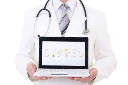 laptop with word stress in doctor's hands isolated on white background photo