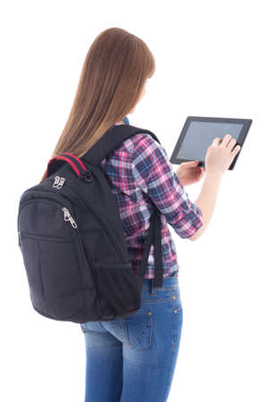 schoolgirl using tablet computer isolated on white background photo