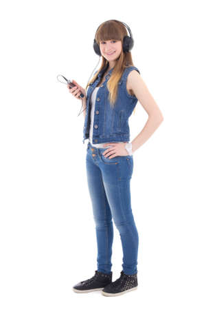 beautiful teenage girl listening music with mobile phone isolated on white background photo