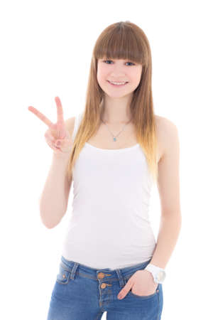 teenage girl in white t-shirt showing victory sign isolated on white background photo