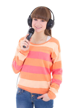 teenage girl with headphones and microphone isolated on white background photo