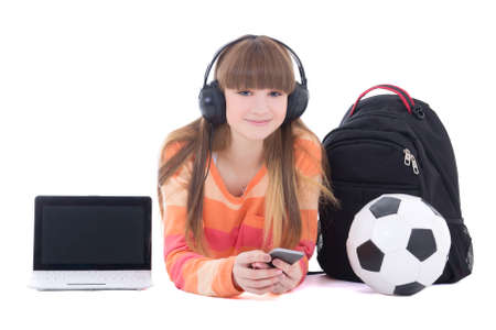 teenage girl in headphones with laptop and phone isolated on white background photo