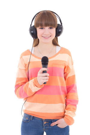 happy teenage girl with headphones and microphone isolated on white background photo