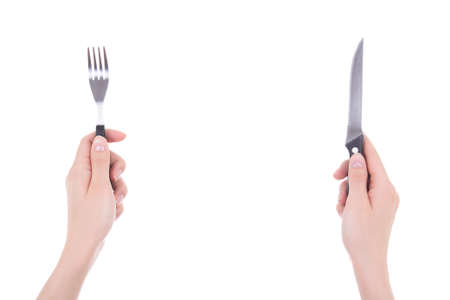 eating right: female hands with fork and knife isolated on white background