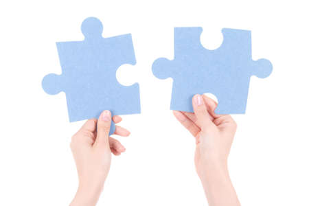 two object: puzzle pieces in woman hands isolated on white background